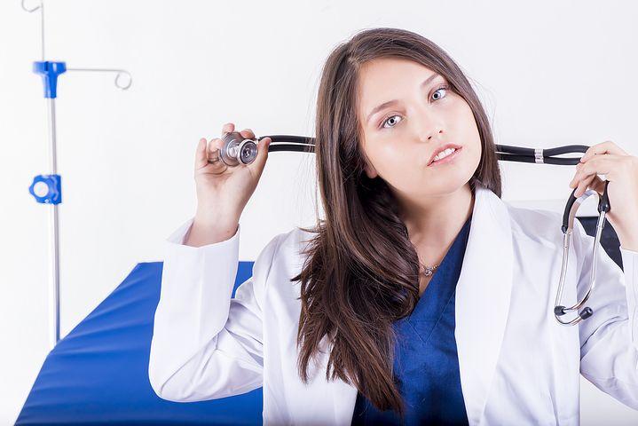 Brisbane female home doctor holding her stethoscope