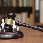 Gavel and an image of a family. Family Law concept