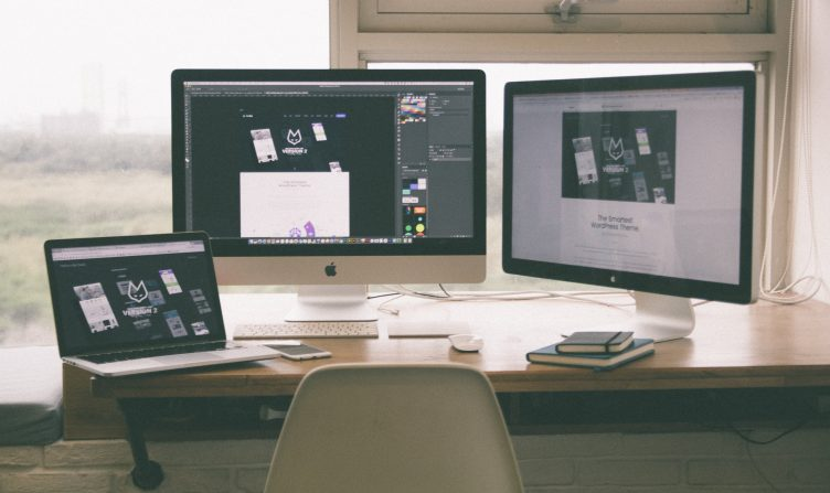 Multiple monitor screens of a graphic designer