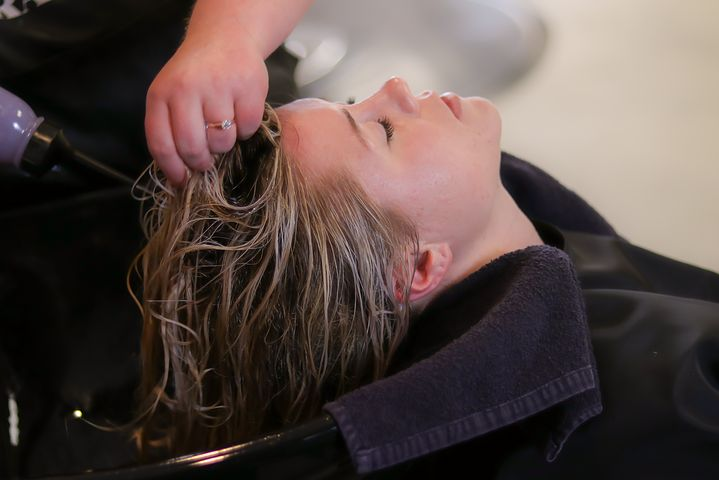 Woman getting a hair treatment in a beauty salon in the CBD