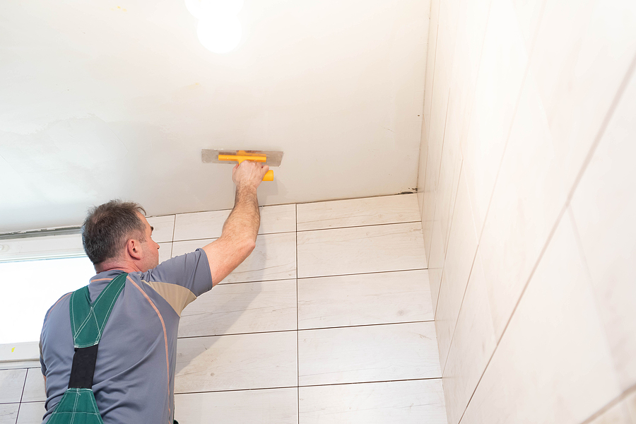 Male worker doing a bathroom renovation
