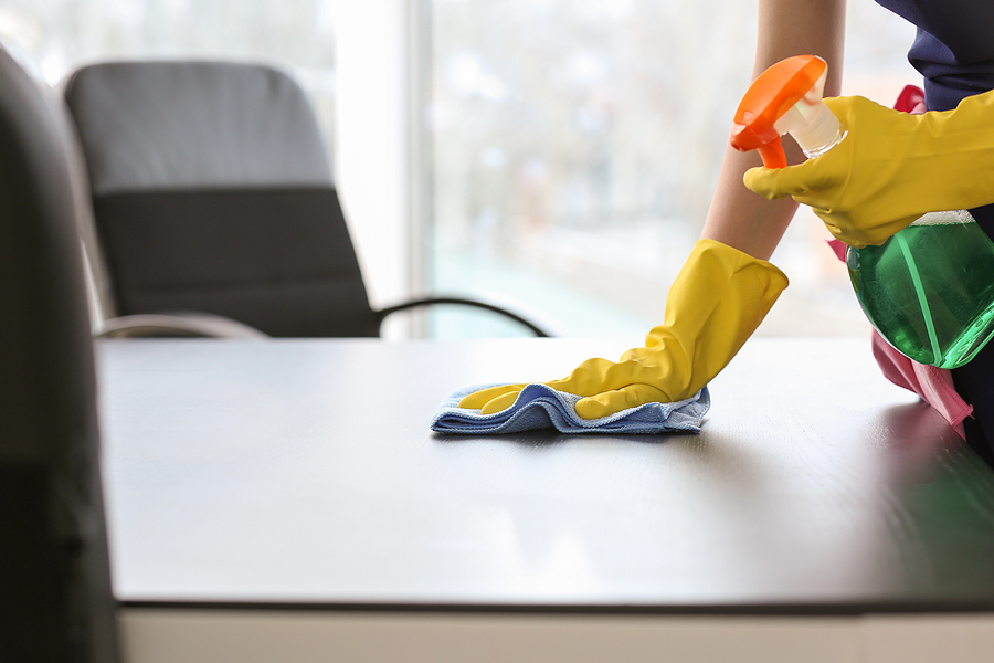 Office cleaner in Sydney cleaning an office table