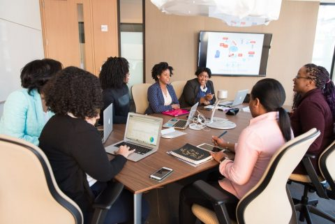 Group of employees while in a meeting