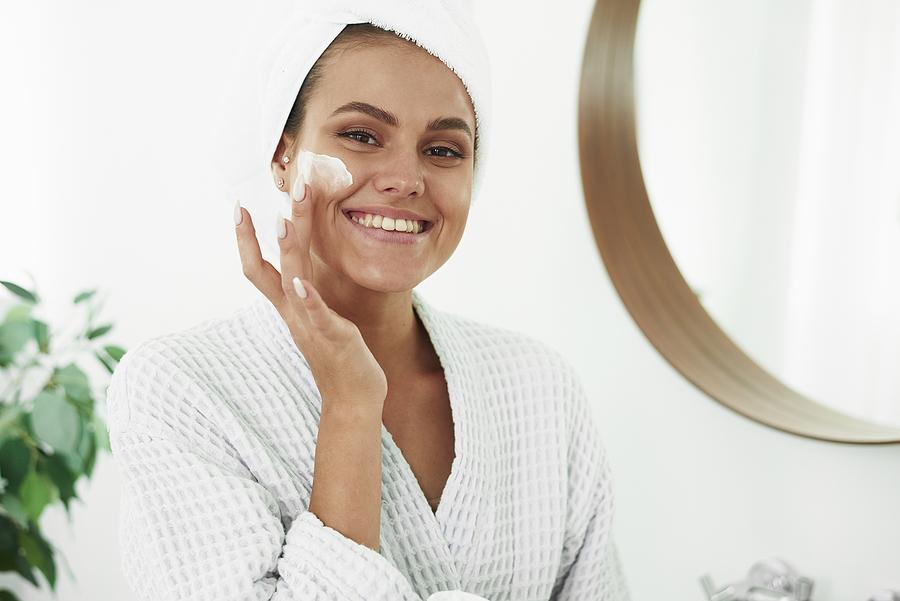 Woman using topical cream as treatments for her vitiligo