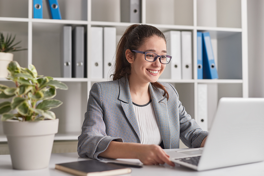 Woman using non profit organization software in her laptop