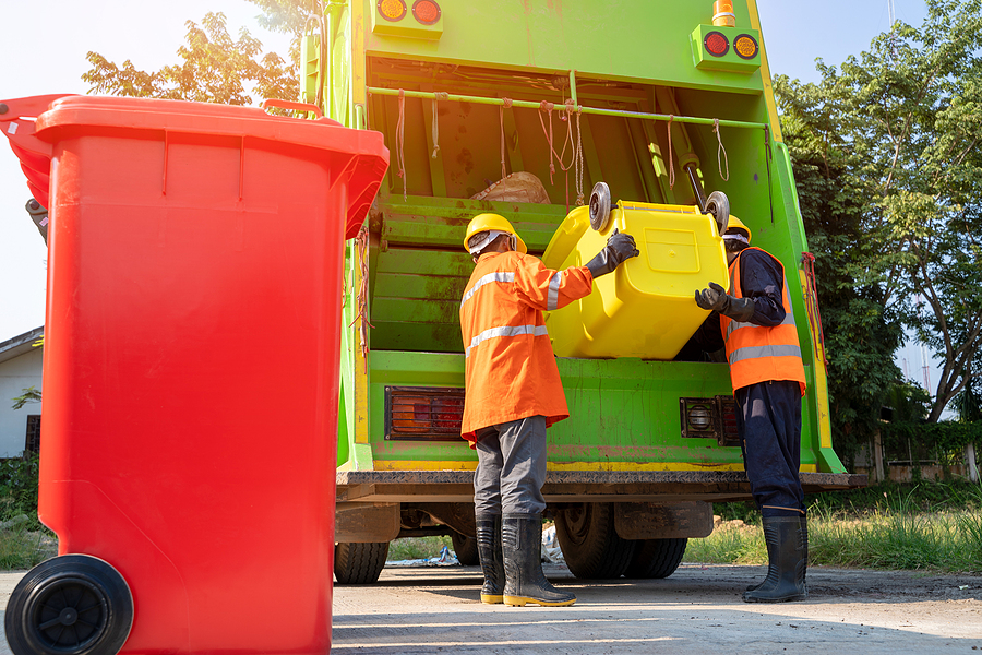 Two workers of a skip bin hire Western Suburbs Melbourne company collecting waste