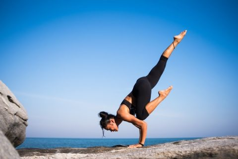 Woman taking yoga online learning classes